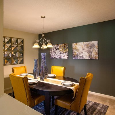 dining room with large table and accent wall